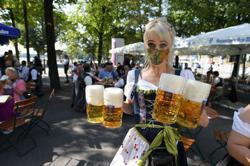 Kegs tapped in Munich pubs for mini-Oktoberfest in shadow of COVID-19