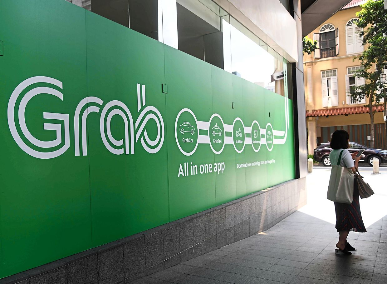 Grab had to pay a fine for data privacy breach. — AFP
