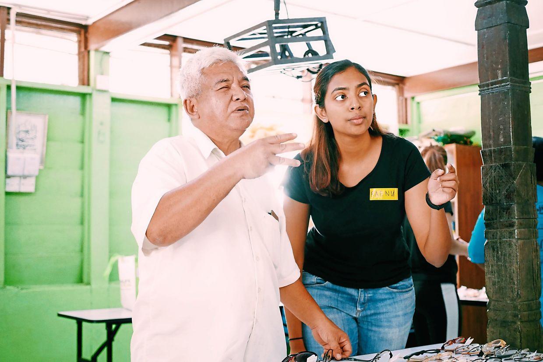 Please read: Raenuga (right) conducting a vision test on a Kampung Orang Asli Serendah villager.