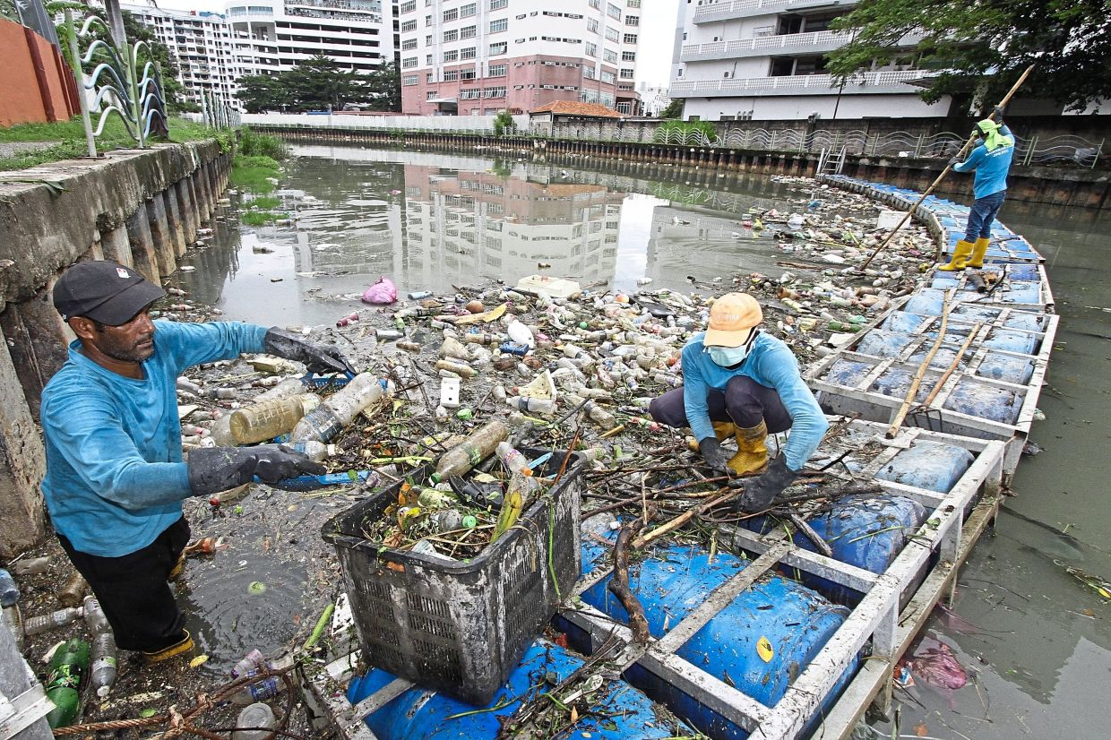 Working 10 hours daily to keep river filth-free