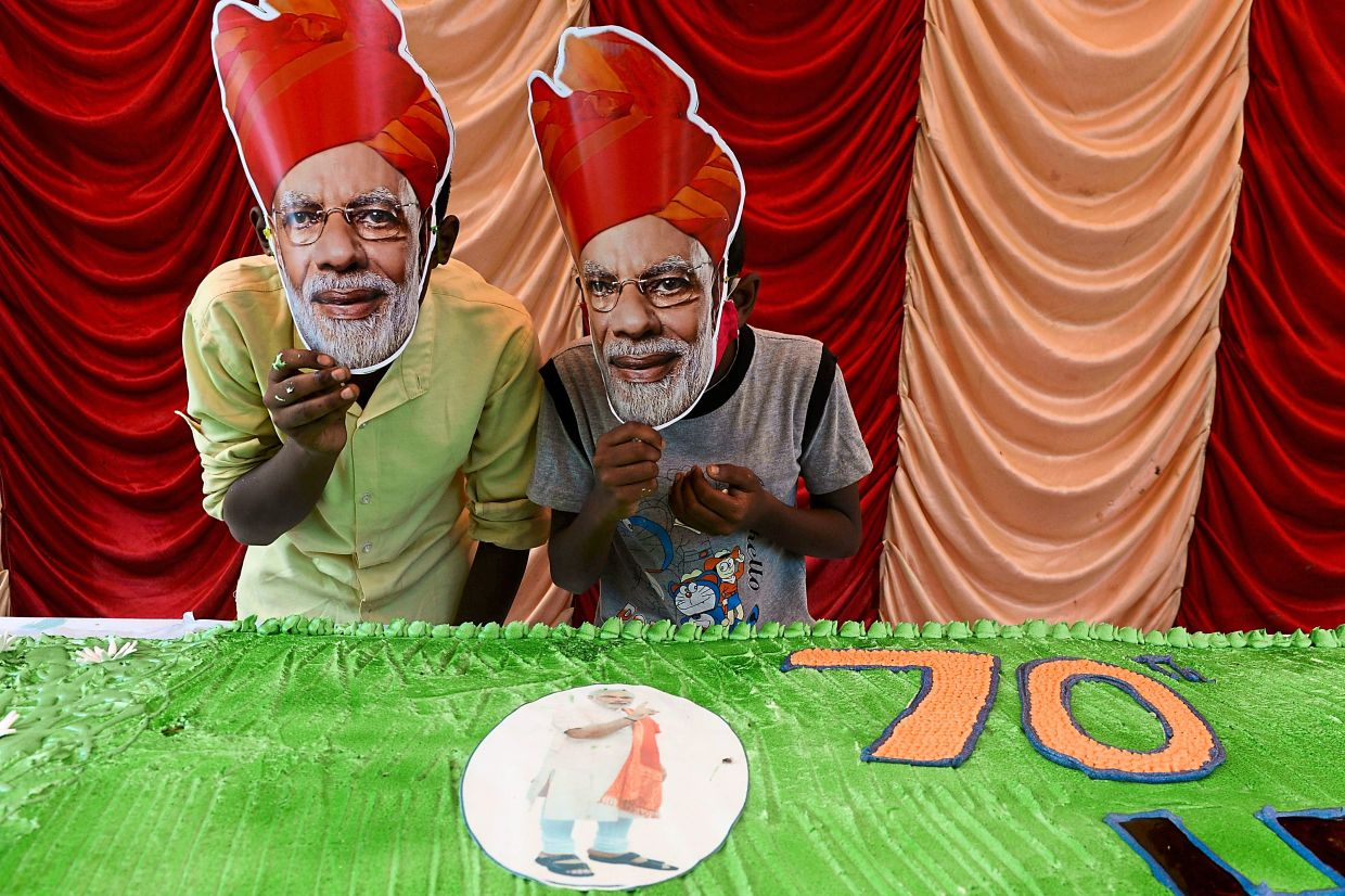 A 70-foot-long cake for 'birthday boy' Modi from his supporters. — AFP