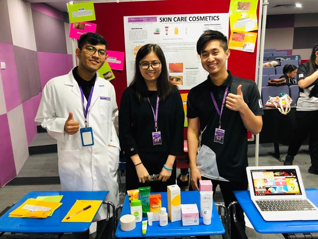 Students set up a booth to promote cosmetic skin care at the Pharmacy poster competition.