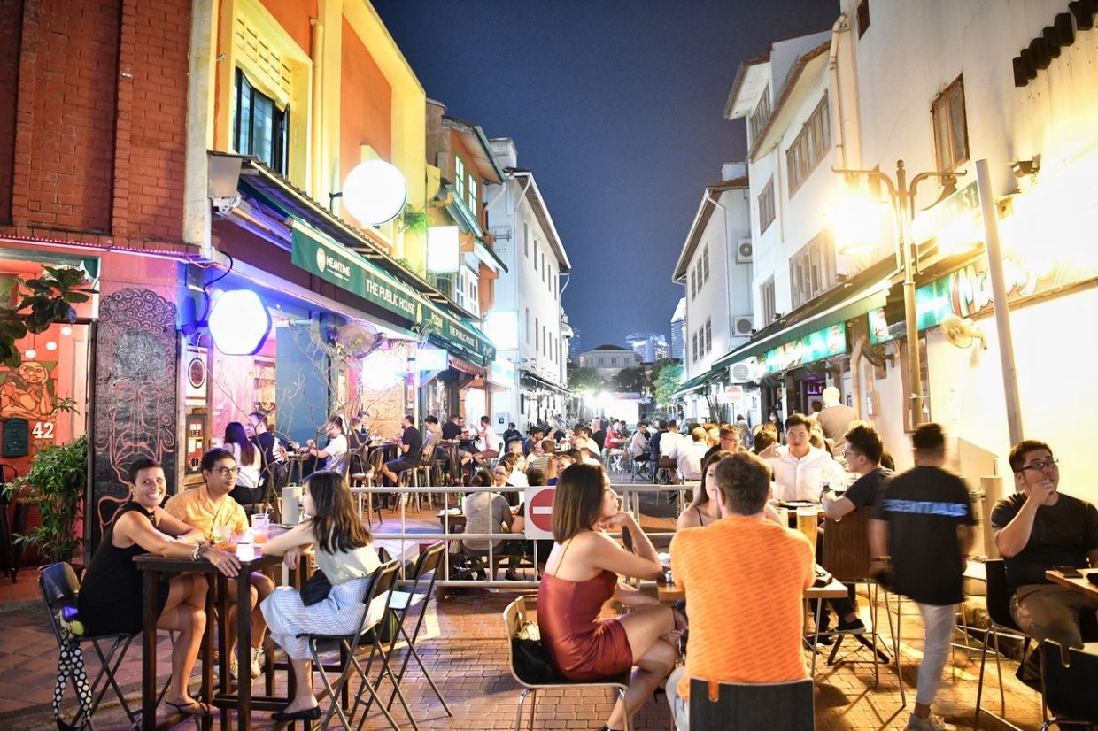 The night crowd at the popular Boat Quay area facing the Singapore riverfront  as seen on Sept 18, 2020. - The Straits Times/Asian News Network