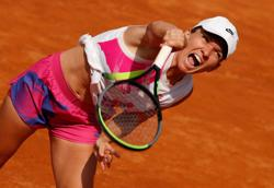 Halep sees off Muguruza to reach Italian Open final