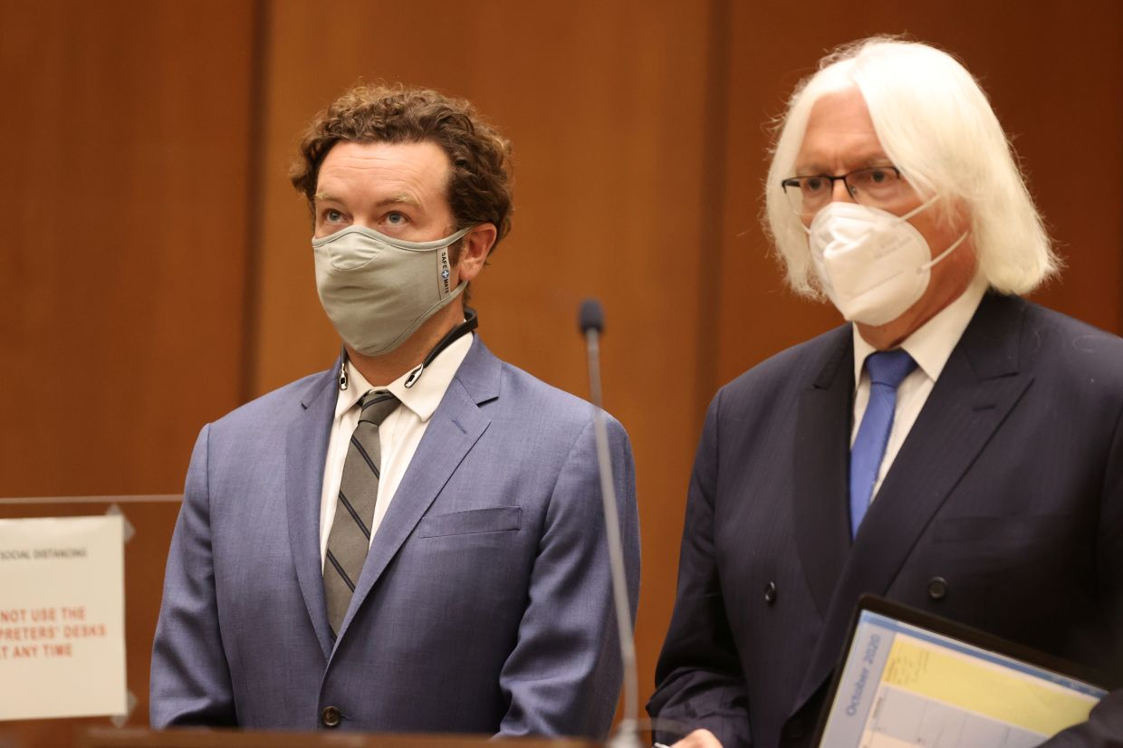 Actor Danny Masterson stands with his lawyer Thomas Mesereau as he is arraigned on three rape charges in separate incidents between 2001 and 2003, at Los Angeles Superior Court, Los Angeles, California, United States, Sept 18, 2020. Photo: Reuters
