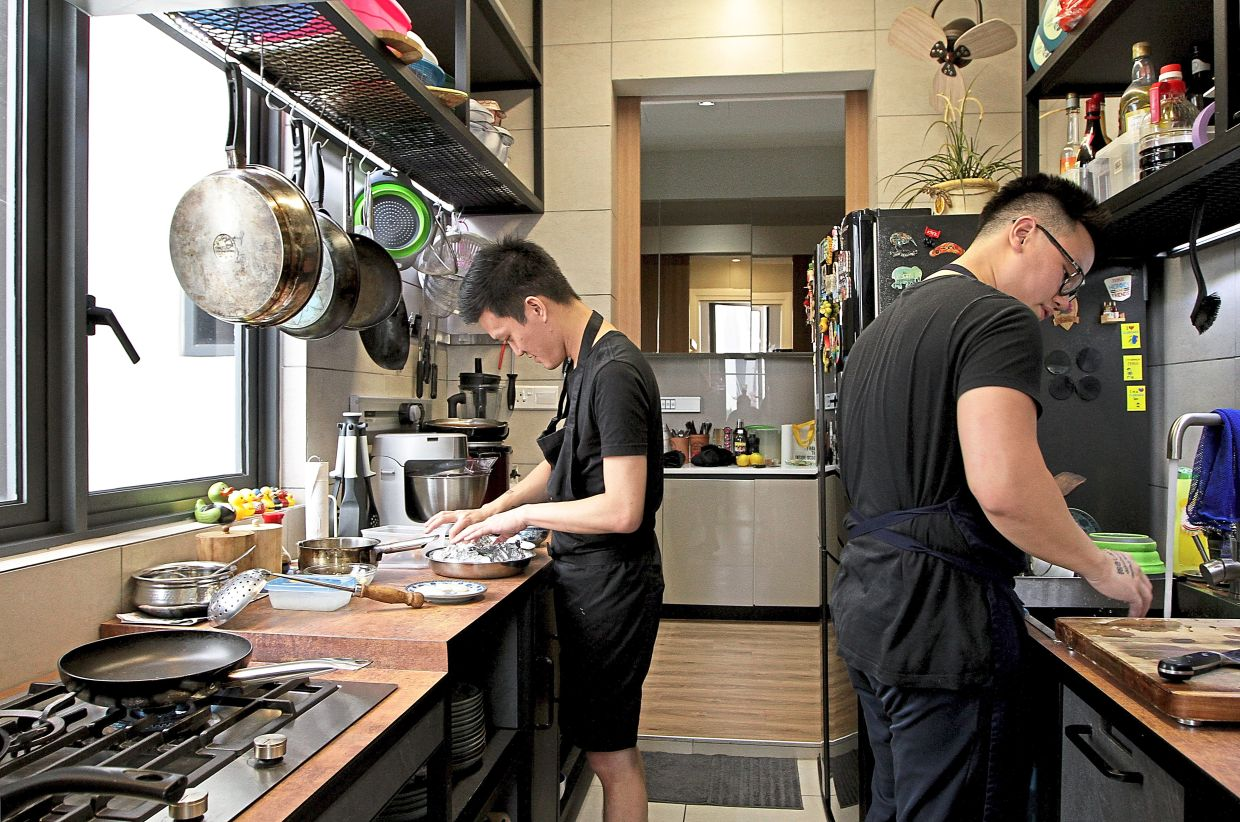 Personal chefs like Lee (left) and Khor often do kitchen visits before cooking at clients' homes as they have to see what sort of equipment is available and prepare accordingly so they can cook well on the day. — YAP CHEE HONG/The Star