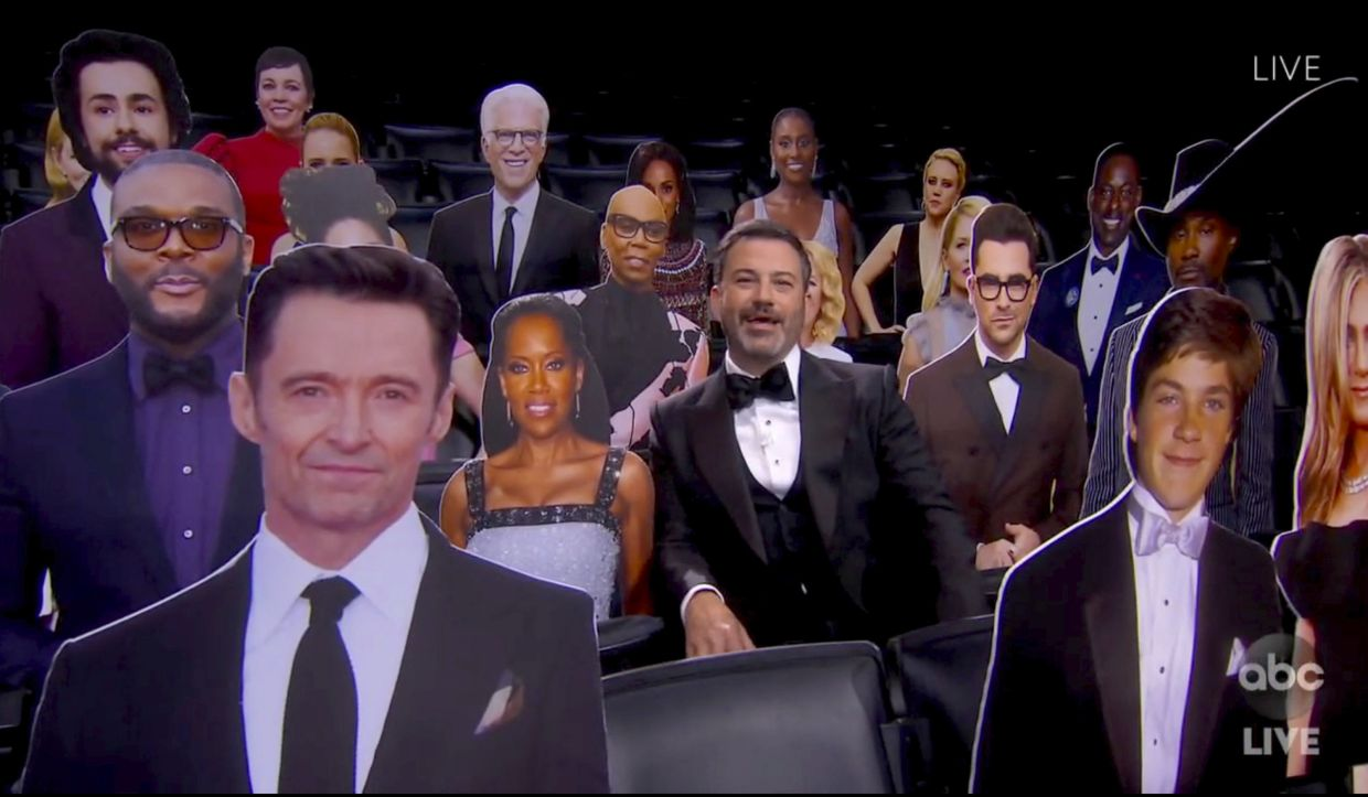 Host Jimmy Kimmel speaks surrounded by cardboard cutouts of actors in the audience during the 72nd Emmy Awards broadcast.