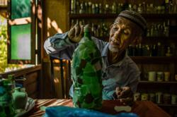Elderly man collects 9,000 seaside bottles, opens 'rumah botol' museum