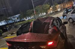 Car damaged by crane in road collision, not falling debris, say cops