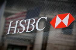 HSBC shares sink to 25-yr low in HK, StanChart sags