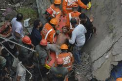 Death toll in building collapse in India rises to 10; 25 still feared trapped inside