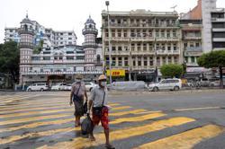 Myanmar locks down biggest city as cases soar ahead of elections