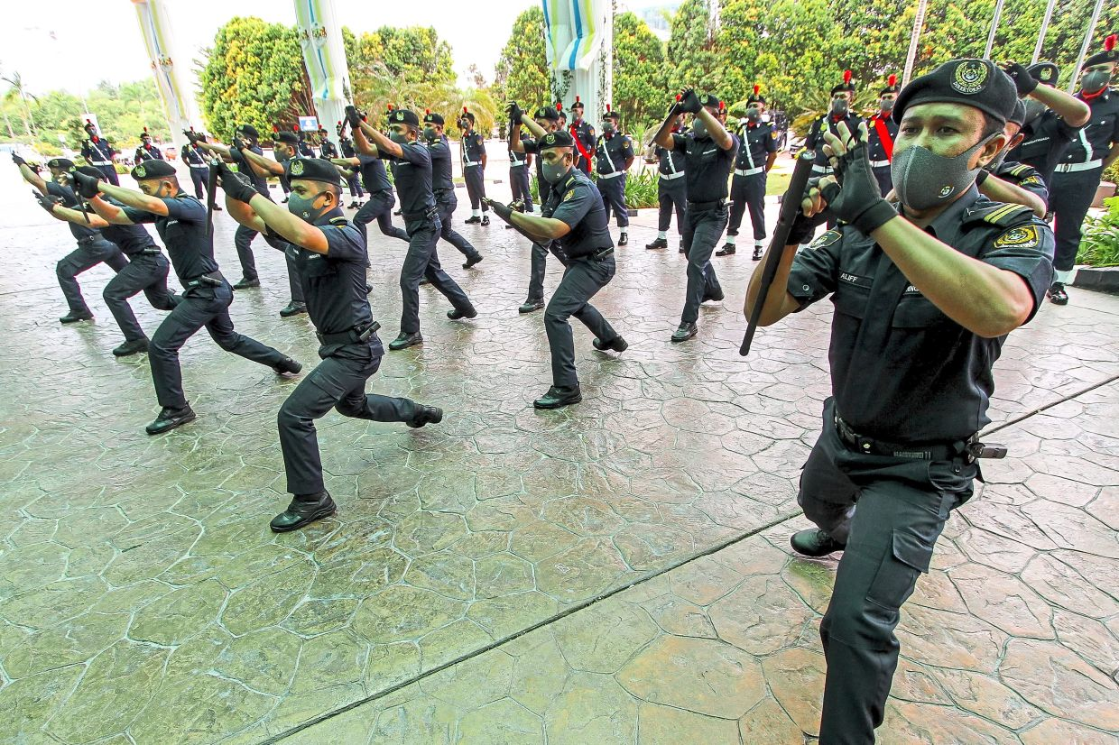 Security personnel putting up a show with their T-batons during the MBSP City Day celebrations at the council headquarters in Bandar Perda, Bukit Mertajam.