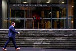 New Zealand central bank to hold rates at record lows