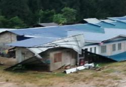 Strong winds lash remote longhouse, tearing roof and awnings