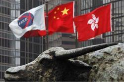 Hong Kong stocks track Asian markets lower on lockdown worries
