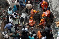 India building collapse death toll climbs to 20, 2nd day search underway