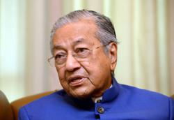 Dr M says he will 'wait and see' what materialises from Anwar's claim
