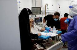 Violence mounts against Iraqi doctors as COVID cases spike