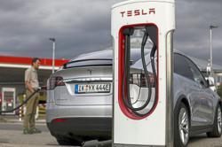 Asian suppliers' stocks slip on Tesla's cheaper battery