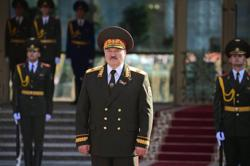 Thousands protest after Belarus president abruptly sworn in - Reuters witness