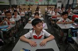 China grants greater autonomy to primary and middle schools