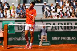 Djokovic out to make amends in Paris for U.S. Open fiasco