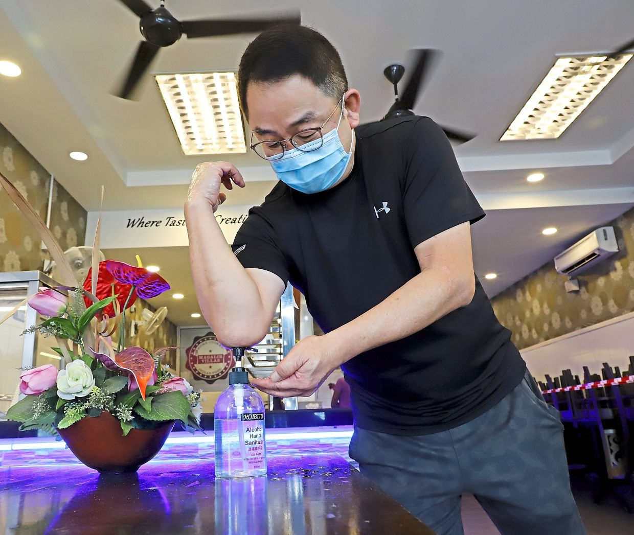 Sanitising or washing your hands regularly and wearing a face mask while in public not only helps prevent the spread of Covid-19, but also all other respiratory infections. — LIM BENG TATT/The Star
