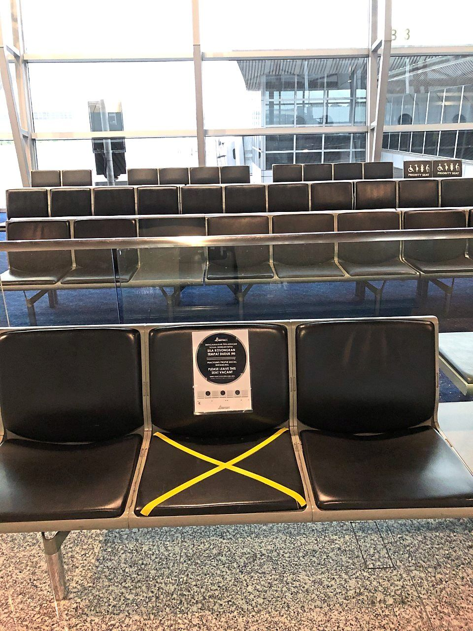An example of confusing messaging: While there is a sign reminding passengers to keep their distance on the seat outside one of the departure gates at KLIA, there are none on the seats inside the gate itself. — Dr MILTON LUM