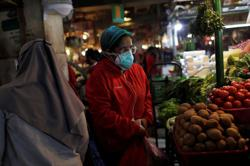 Indonesia says distribution of social aid has improved, will help economy
