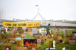 Abiding by COVID-19 curbs, Australian school kids protest in opposition to gas