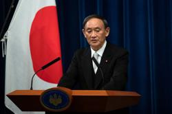 Japan to allow foreign long-term residents in from October, PM Suga says