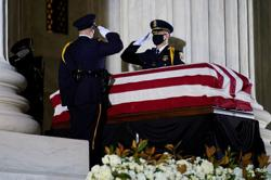 Tears and push-ups for Ginsburg, first woman to lie in state at U.S. Capitol
