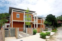 Malaysian house constructed with shipping containers exudes traditional charm