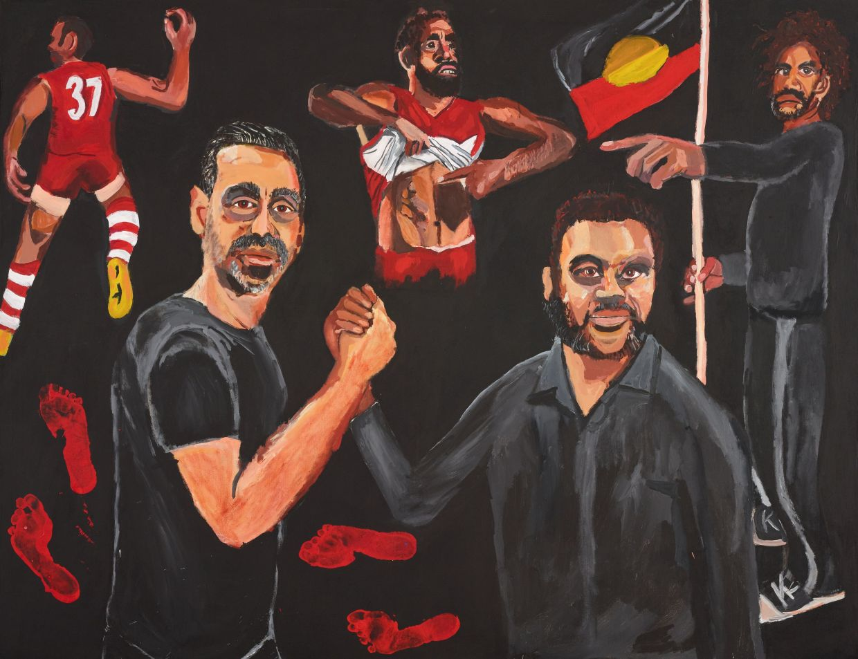 'We share some similar stories and experiences - of disconnection from culture, language and country, and the constant pressures of being an Aboriginal man in this country,' says Namatjira of  his portrait tribute to indigenous footballer and activist Adam Goodes. Photo: Reuters