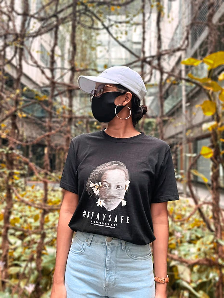 Leny has also launched a limited edition T-shirt range of her pandemic-inspired artwork. Photo: Leny Maknoh