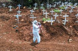 World News Day: Covering a Covid-19 burial — The photojournalists' stories