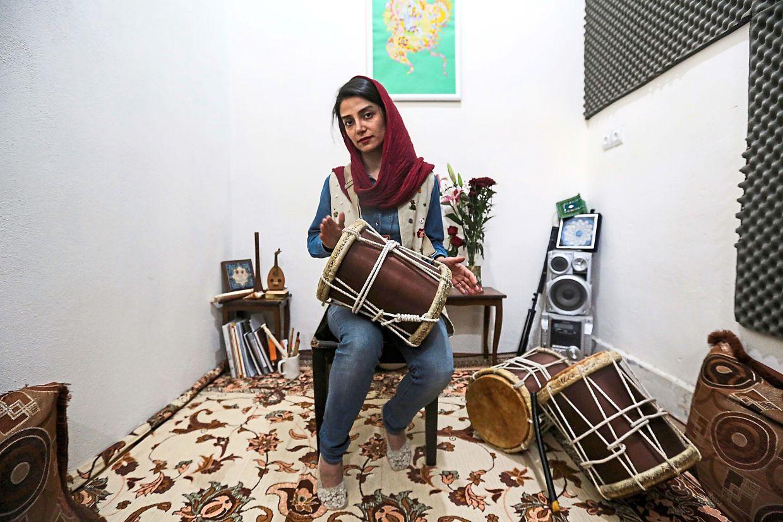 Negin Heydari, a former member of the all-women Iranian music band Dingo, plays the kasser drum. Photo: AFP/Atta Kenare