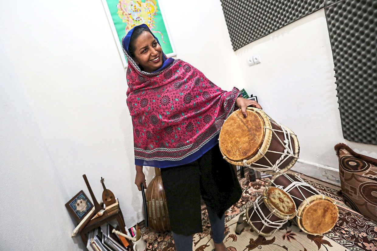 Malihe Shahinzadeh, a member of the all-women Iranian music band Dingo, plays the pippeh drum. Photo: AFP/Atta Kenare