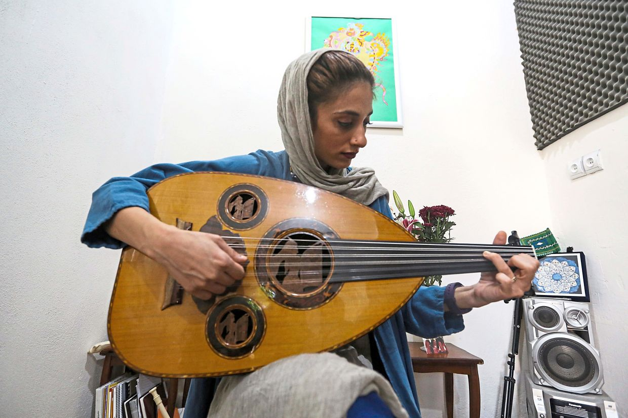Noushin Yousefzadeh from the all-women Iranian music band Dingo, plays the oud (Middle Eastern lute). Photo: AFP/Atta Kenare