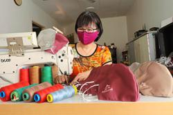 Tailor switches to sewing face masks