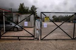 Greece says first migrant dies of COVID-19 since the pandemic