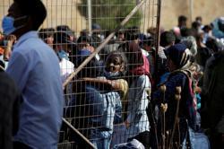 Greek police probe aid workers on Lesbos island