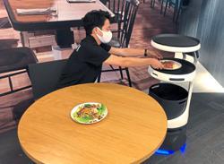 SoftBank brings food service robot to Japan