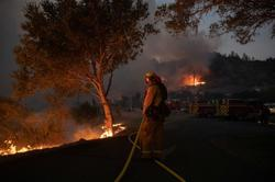 Evacuations expanded as California wine country fire spreads quickly