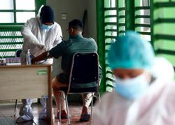Indonesia reports 4,002 new coronavirus infections, 128 deaths