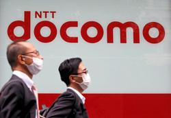 Insight - Docomo buyout shows 'dumb pipes' no longer cut it