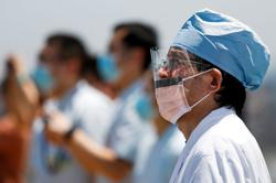 Japan health workers snub COVID-19 database as PM Suga seeks to digitise government