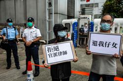 Families fear for Hong Kong fugitives in custody