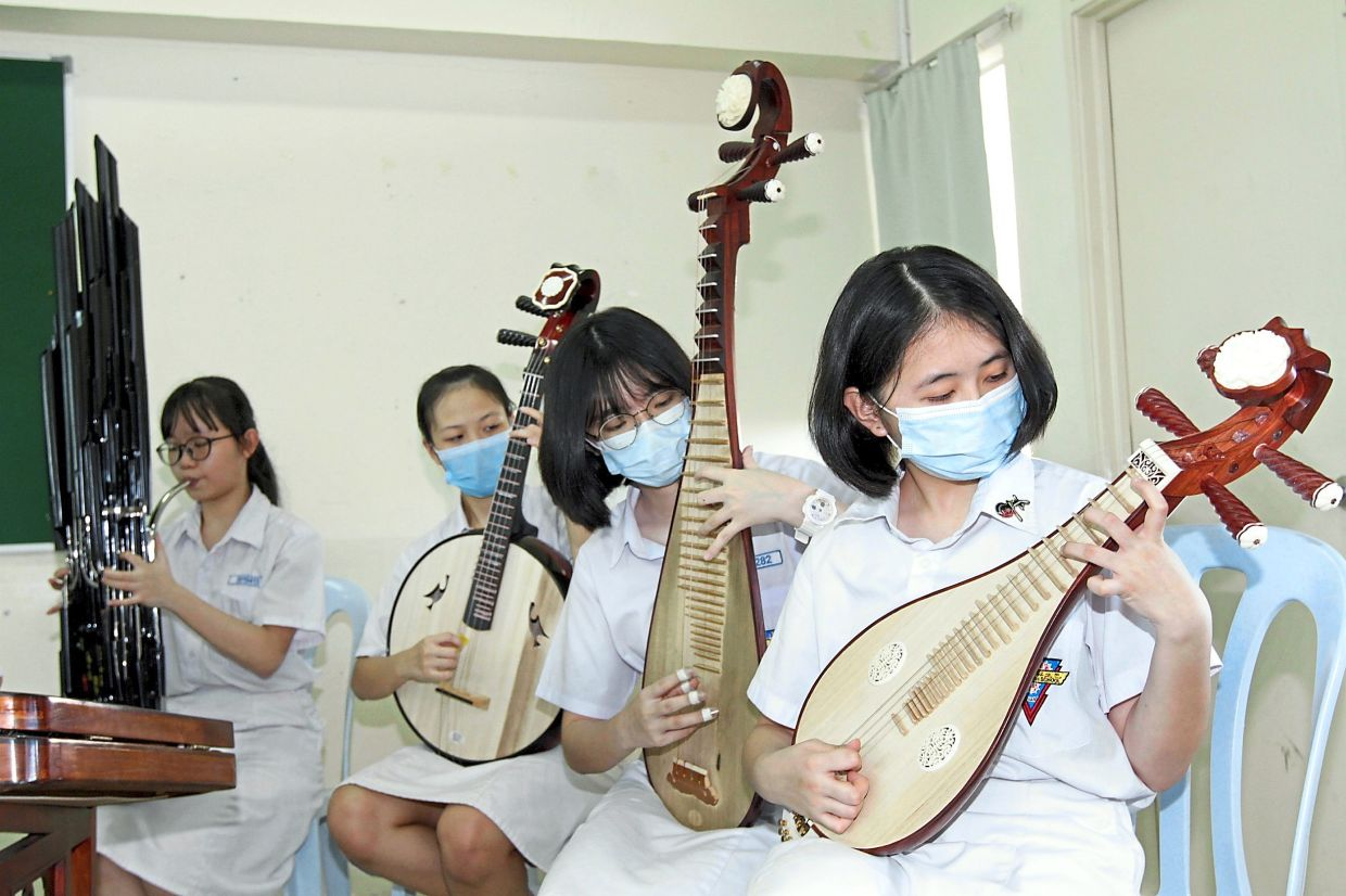 Crystal (second from right) prefers playing in an orchestra compared to a solo act.